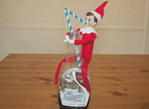 elf-on-the-shelf-ideas-elf-drinking-the-syrup